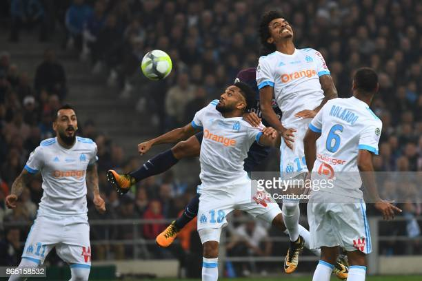 Marseille's French defender Jordan Amavi and Marseille's Brazilian midfielder Luiz Gustavo jump for the ball during the French L1 football match...