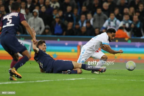 Marseille's French defender Jordan Amavi and Paris SaintGermain's Belgian defender Thomas Meunier vie for the ball during the French L1 football...