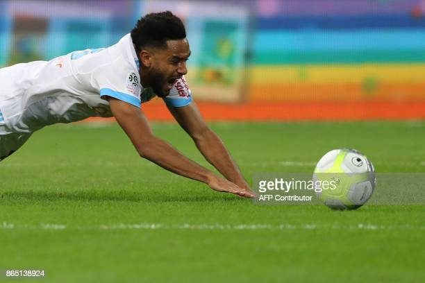 Marseille's French defender Jordan Amavi falls during the French L1 football match between Marseille and Paris SaintGermain on October 22 at the...
