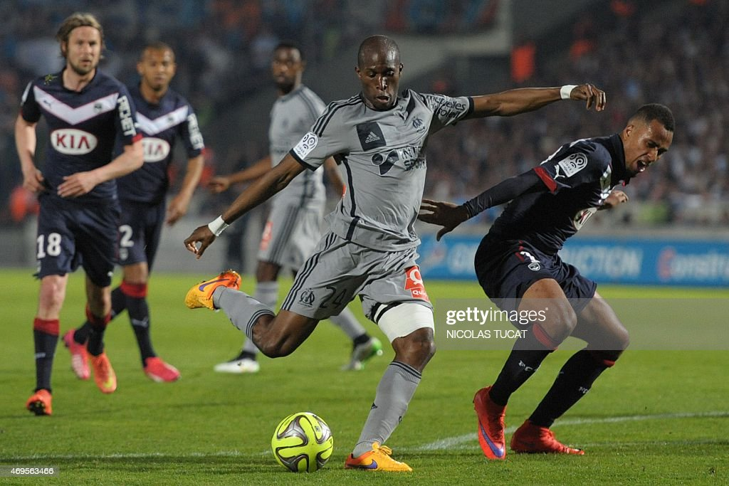 Marseille's French defender Rod Fanni shoots the ball during a French L1 football match between Bordeaux and Marseille on April 12 2015 at the...