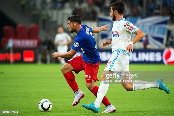 Marseille's French defender Stephane Sparagna vies with Caen's French forward Andy Delort during the French L1 football match between Olympique de...
