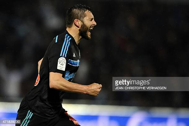 Marseille's French forward AndrePierre Gignac celebrates after scoring a goal during the French L1 football match between Metz and Marseille on May 1...