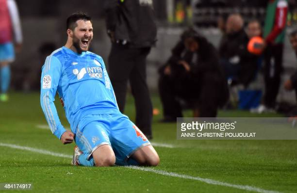 Marseille's French forward AndrePierre Gignac celebrates sliding on his knees after scoring a goal on April 11 2014 at the Mosson stadium in...