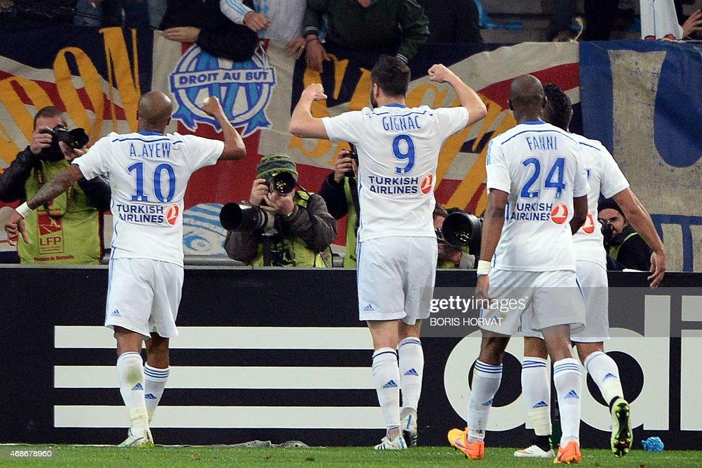 Marseille's French forward AndrePierre Gignac celebrates with Marseille's Ghanaian midfielder Andre Ayew and Marseille's French defender Rod Fanni...