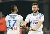 Marseille's French forward AndrePierre Gignac celebrates with Marseille's French forward Dimitri Payet after scoring during the French L1 football...