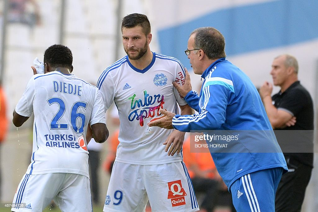 Marseille's French forward AndrePierre Gignac gestures with Marseille's Argentinian head coach Marcelo Bielsa after the second goal during their...
