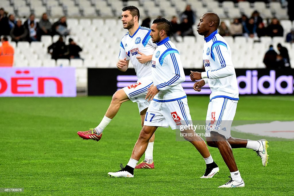Marseille's French forward AndrePierre Gignac Marseille's French forward Dimitri Payet and Marseille's French defender Rod Fanni warm up before the...