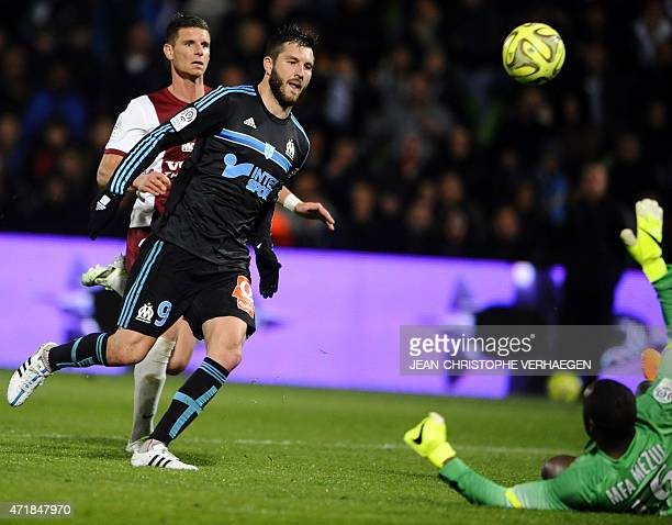 Marseille's French forward AndrePierre Gignac scores a goal despite of Metz' French Gabonese goalkeeper Anthony Mfa during the French L1 football...