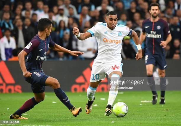 Marseille's French forward Dimitri Payet vies for the ball with Paris SaintGermain's Brazilian defender Marquinhos during the French L1 football...