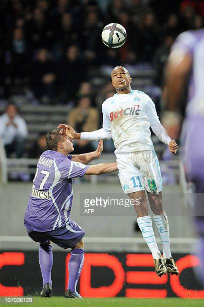Marseille's French forward Loic Remy heads the ball upon Toulouse's French defender Franck Tabanou during their French L1 football match Toulouse vs...