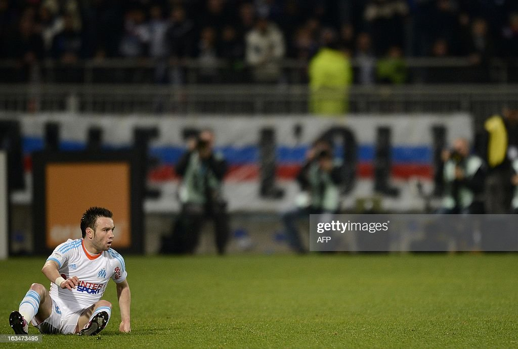 Marseille's French forward Mathieu Valbuena lies on the field during the French L1 football match Olympique Lyonnais (OL) vs Olympique de Marseille (OM) on March 10, 2013 at the Gerland stadium in Lyon, southeastern France.
