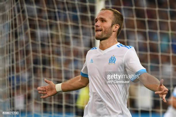 Marseille's French forward Valere Germain reacts after scoring a goal during the UEFA Europa League playoff round second leg football match between...