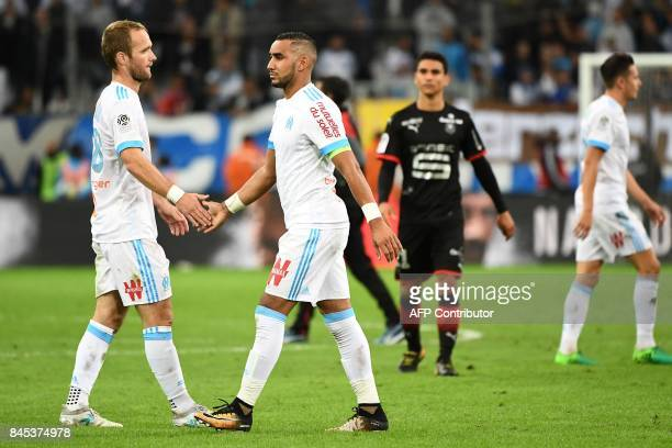 Marseille's French forward Valere Germain shakes hands with French forward Dimitri Payet as they react as the end of the French L1 football match...