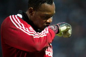 Marseille's French goalkeeper Steve Mandanda adjusts his gloves as he practices prior to the French L1 football match Marseille vs Lyon on May 4 2014...