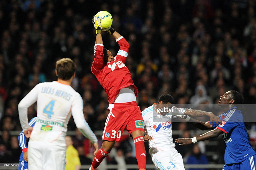Marseille's French goalkeeper Steve Mandanda catches the ball during the French L1 football match Olympique Lyonnais (OL) vs Olympique de Marseille (OM) on March 10, 2013 at the Gerland stadium in Lyon, southeastern France.