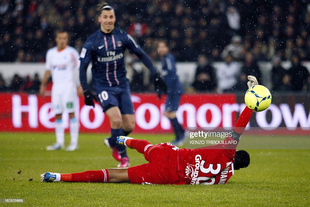 Marseille's French goalkeeper Steve Mandanda fails to save a goal during the French L1 football match Paris Saint-Germain (PSG) vs Olympique de Marseille (OM) on February 24, 2013 at the Parc des Princes stadium in Paris. AFP PHOTO KENZO TRIBOUILLARD