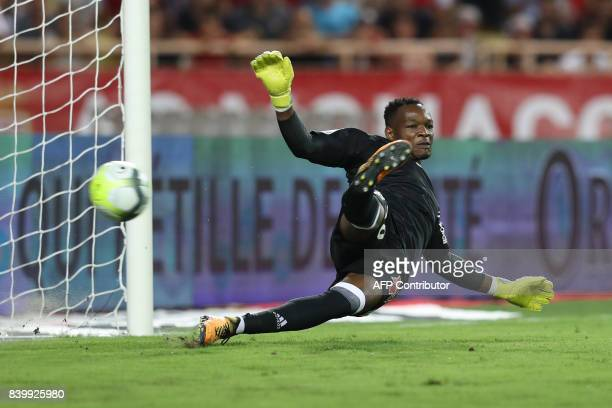 Marseille's French goalkeeper Steve Mandanda fails to stop a penalty kick during the French L1 football match between Monaco and Marseille on August...