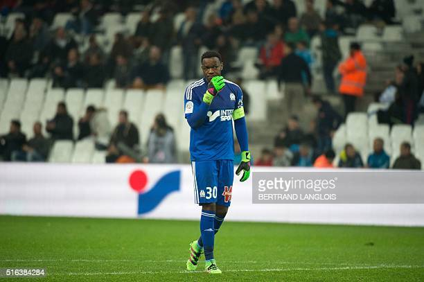 Marseille's French goalkeeper Steve Mandanda gestures during the French L1 football match Olympique de Marseille vs Rennes on March 18 2016 at the...