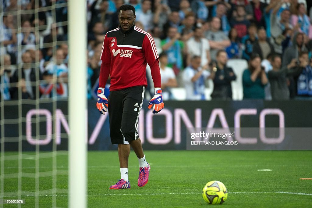 Marseille's French goalkeeper Steve Mandanda looks at the ball before the French L1 football match between Marseille and Lorient on April 24 2015 at...