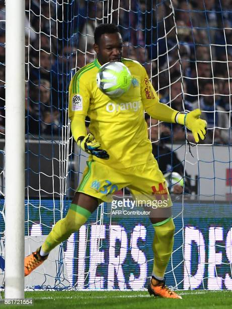 Marseille's French goalkeeper Steve Mandanda stops the ball during the French Ligue 1 football match between Strasbourg and Marseille on October 15...