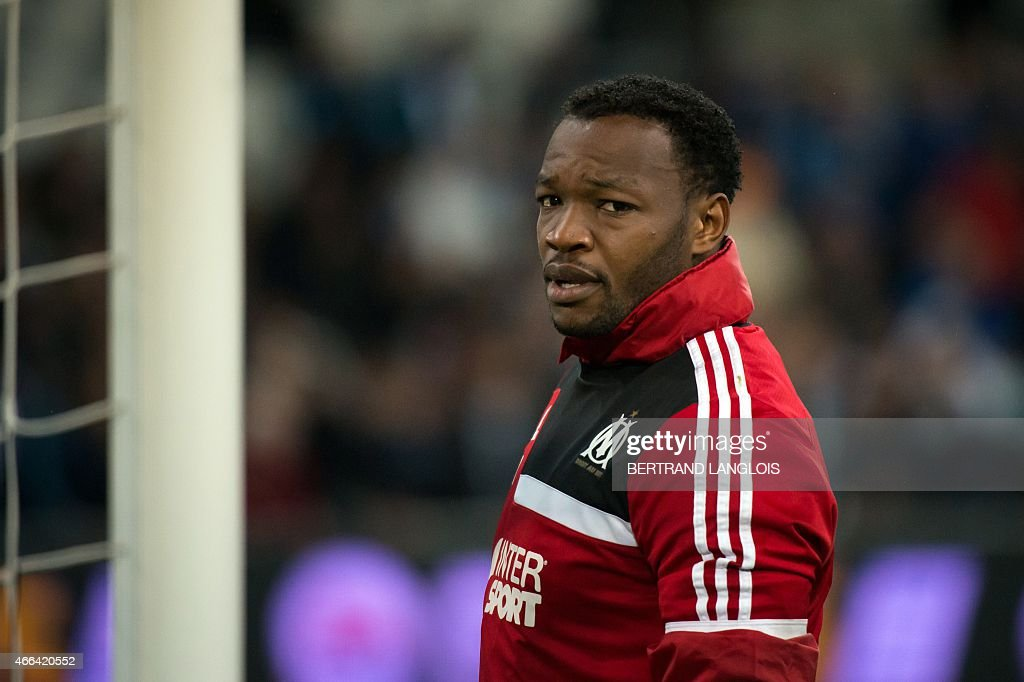 Marseille's French goalkeeper <a gi-track='captionPersonalityLinkClicked' href=/galleries/search?phrase=Steve+Mandanda&family=editorial&specificpeople=4470005 ng-click='$event.stopPropagation()'>Steve Mandanda</a> warms up ahead of the French L1 football match Olympique de Marseille (OM) vs Lyon (OL), on March 15, 2015 at the Velodrome stadium in Marseille, southern France. AFP PHOTO / BERTRAND LANGLOIS