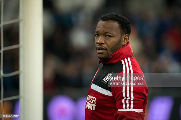 Marseille's French goalkeeper Steve Mandanda warms up ahead of the French L1 football match Olympique de Marseille vs Lyon on March 15 2015 at the...