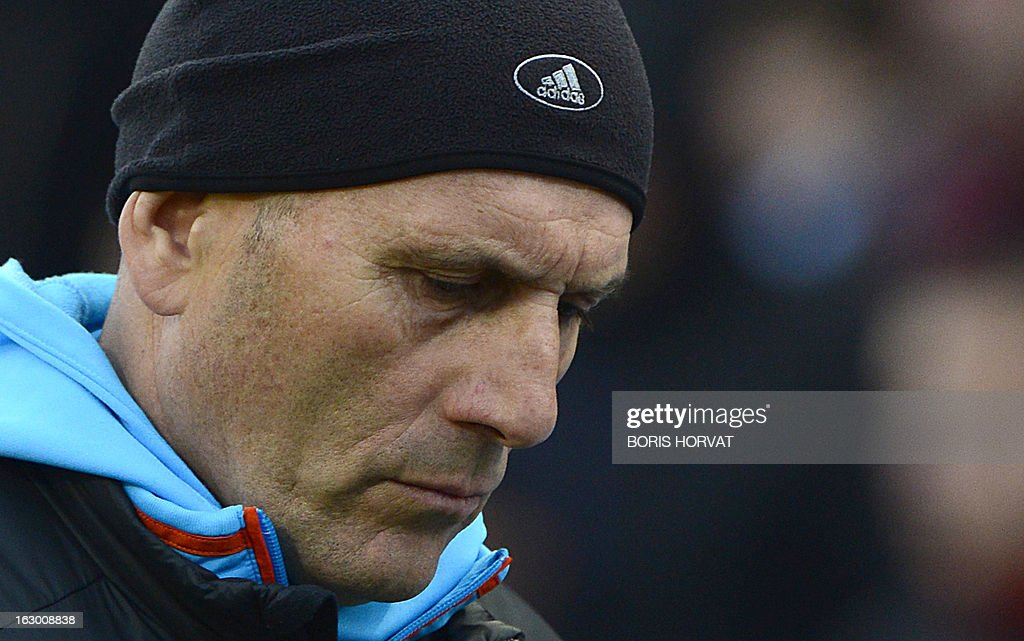 Marseille's French head coach Elie Baup leaves the pitch at half-time during the French L1 football match Olympique of Marseille (OM) versus Troyes (ESTAC) at the Velodrome stadium in Marseille, on March 3, 2013.
