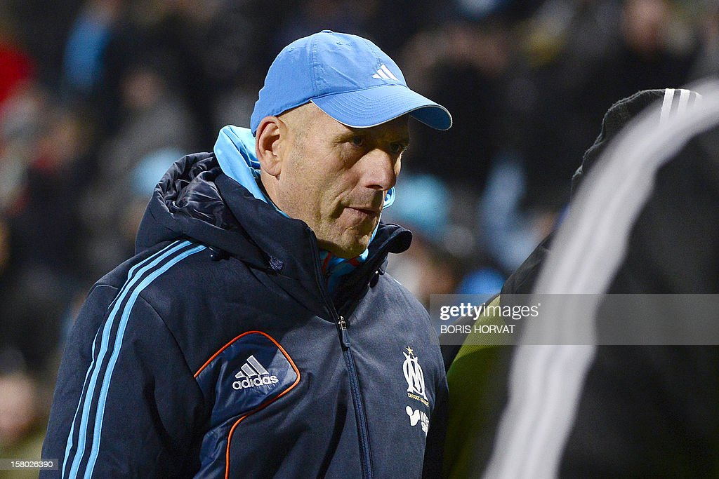 Marseille's French head coach Elie Baup leaves the pitch at the end of their French L1 football match Olympique of Marseille (OM) versus Lorient (FCL) at the Velodrome stadium in Marseille, on December 9, 2012.
