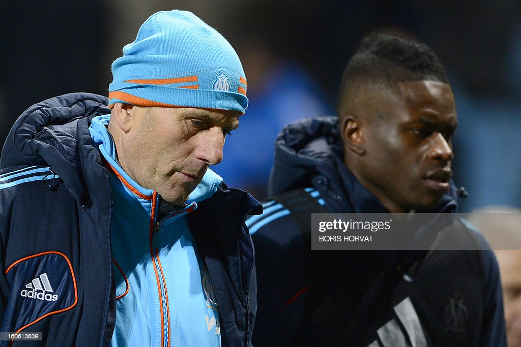Marseille's French head coach Elie Baup (L) (L) looks on after play during their French L1 football match Olympique of Marseille (OM) versus Nancy (ASNL) at the Velodrome stadium in Marseille on February 3, 2013. AFP PHOTO / BORIS HORVAT