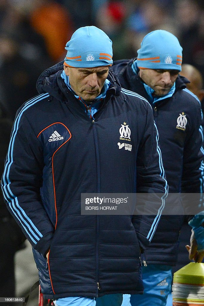 Marseille's French head coach Elie Baup (L) looks on after play during their French L1 football match Olympique of Marseille (OM) versus Nancy (ASNL) at the Velodrome stadium in Marseille on February 3, 2013.