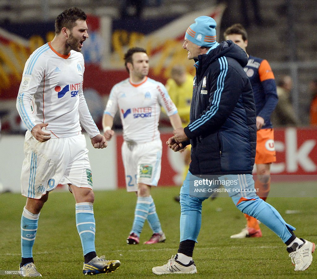 Marseille's French midfielder Andre Pierre Gignac (L) celebrates with Marseille's French head coach Elie Baup (R) after winning the French L1 football match Marseille (OM) vs Montpellier (MHSC) on January 19, 2013 at the Velodrome stadium in Marseille, southern France.