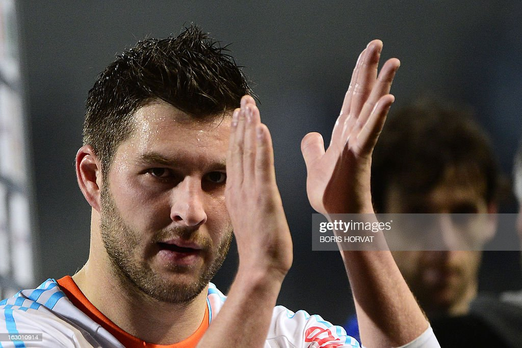 Marseille's French midfielder Andre Pierre Gignac gestures after winning the French L1 football match Marseille (OM) vs Troyes (ESTAC) at the Velodrome stadium in Marseille on March 3, 2013. AFP PHOTO / BORIS HORVAT