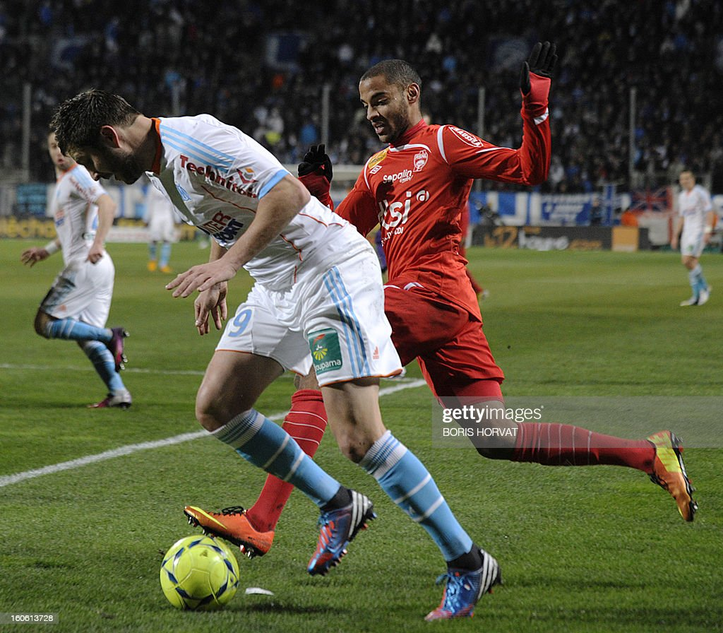 Marseille's French midfielder Andre Pierre Gignac (L) vies with Nancy's French defender Yassine Jebbour (R) during their French L1 football match Olympique of Marseille (OM) versus Nancy (ASNL) at the Velodrome stadium in Marseille on February 3, 2013.