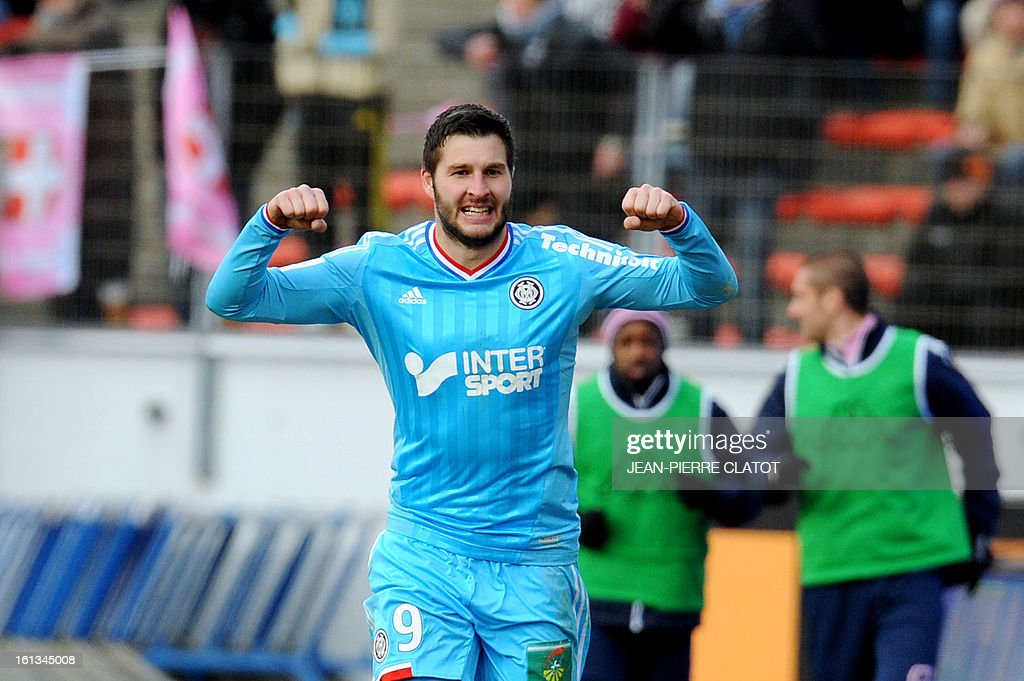 Marseille's French midfielder Andre-Pierre Gignac celebrates after scoring a goal during the French L1 football match Evian (ETGFC) vs Olympique de Marseille (OM) on February 10, 2013 at the city stadium Parc-des-sports in Annecy, eastern France.