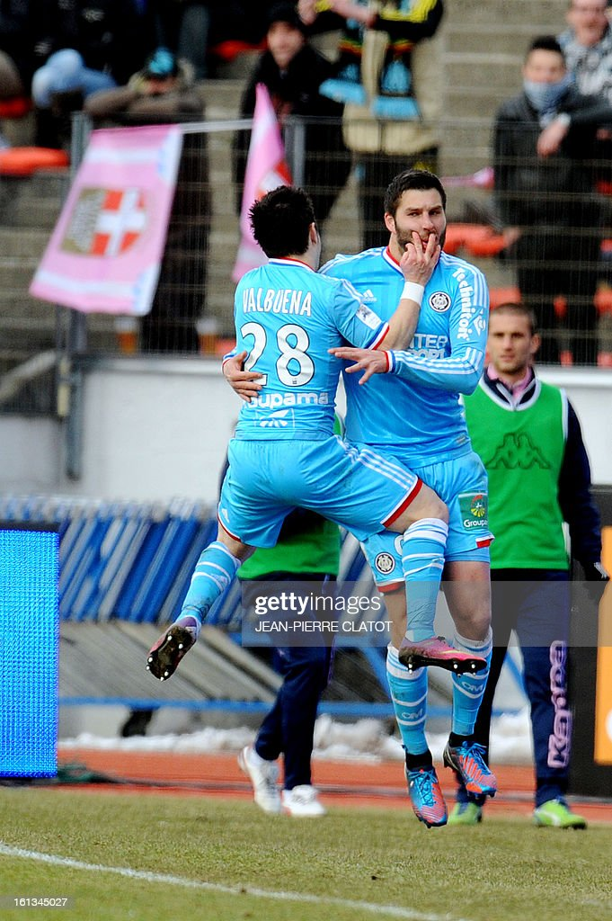 Marseille's French midfielder Andre-Pierre Gignac (R) celebrates after scoring a goal during the French L1 football match Evian (ETGFC) vs Olympique de Marseille (OM) on February 10, 2013 at the city stadium Parc-des-sports in Annecy, eastern France.