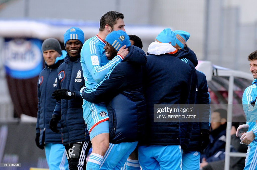 Marseille's French midfielder Andre-Pierre Gignac (L) celebrates with teammates after scoring a goal during the French L1 football match Evian (ETGFC) vs Olympique de Marseille (OM) on February 10, 2013 at the city stadium Parc-des-sports in Annecy, eastern France. AFP PHOTO / JEAN-PIERRE CLATOT