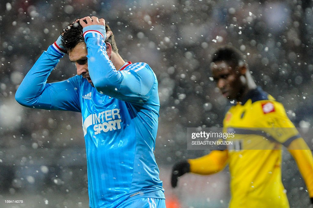 Marseille's French midfielder Andre-Pierre Gignac (L) reacts during the French L1 football match Sochaux (FCSM) versus Marseille (OM) at the August Bonal Stadium in Montbeliard, on January 13, 2013.