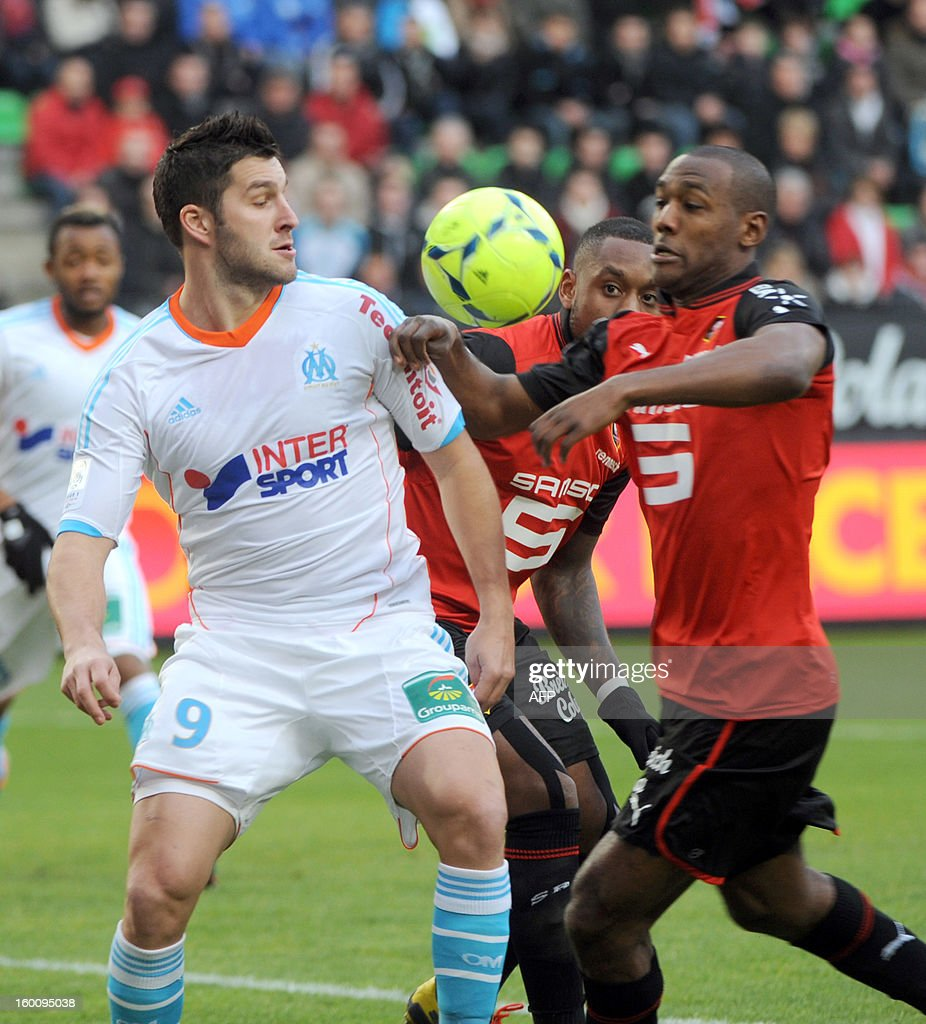 Marseille's French midfielder Andre-Pierre Gignac (L) vies with Rennes' French defender Kevin Theophile Catherine (R) during their French L1 football match Stade Rennais FC vs. Marseille, on January 26, 2013 at the route de Lorient stadium in Rennes, western France.