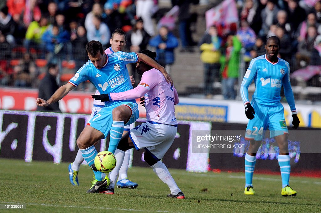Marseille's French midfielder Benoit Cheyrou (L) vies with Evian's Ivoirian midfielder Eric Tie Bi during the French L1 football match Evian (ETGFC) vs Marseille (OM) on February 10, 2013 at the city stadium Parc des sports in Annecy, eastern France.