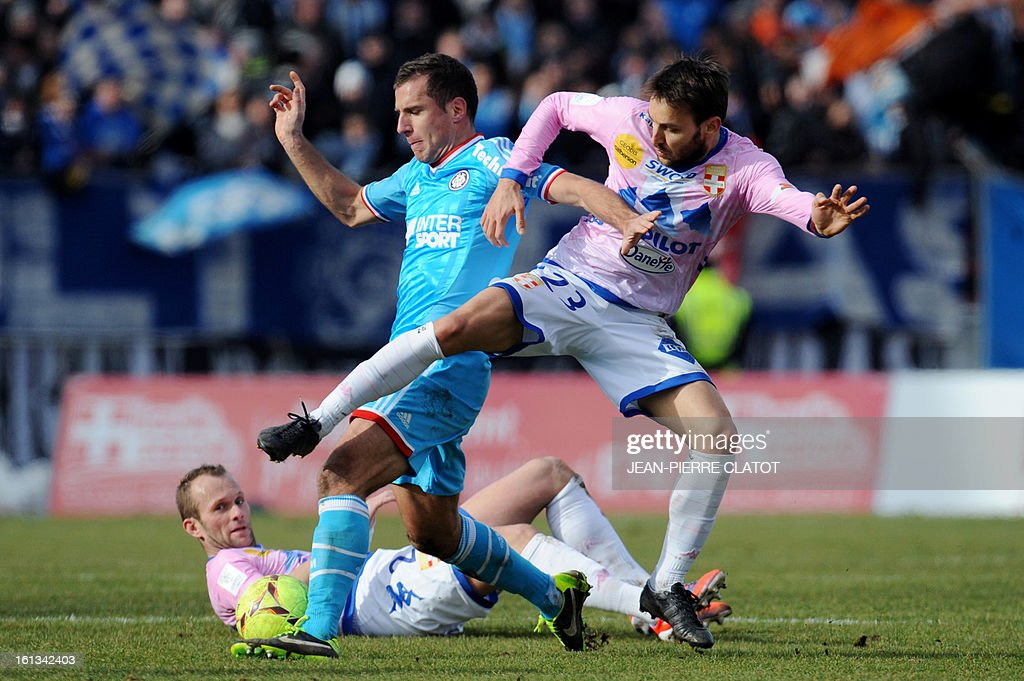 Marseille's French midfielder Benoit Cheyrou (L) vies with Evian's Serbian midfielder Milos Ninkovic during their French L1 football match Evian (ETGFC) vs Marseille (OM) February 10, 2013 at the Parc des sports in Annecy, eastern France.