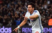 Marseille's French midfielder Florian Thauvin celebrates after opening the scoring during the French L1 football match Marseille vs Nantes on...