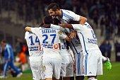 Marseille's French midfielder Florian Thauvin celebrates with teammates Abdelaziz Barrada AndrePierre Gignac and Mario Lemina after Thauvin opened...