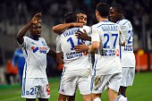 Marseille's French midfielder Florian Thauvin celebrates with teammates Brice Dja Djedje Dimitri Payet Abdelaziz Barrada and Giannelli Imbula after...
