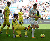 Marseille's French midfielder Florian Thauvin dribbles Nantes' French defender Koffi Djidji prior to scoring an equalizer during the French L1...