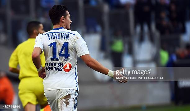 Marseille's French midfielder Florian Thauvin gestures after scoring a goal during the French L1 football match Marseille vs Lille on December 21...