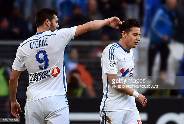 Marseille's French midfielder Florian Thauvin is gongratulated by Marseille's French forward AndrePierre Gignac after scoring a goal during the...