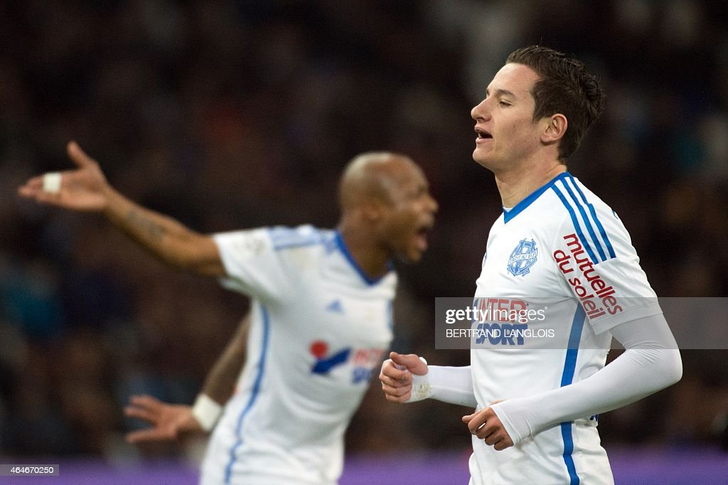 Marseille's French midfielder <a gi-track='captionPersonalityLinkClicked' href=/galleries/search?phrase=Florian+Thauvin&family=editorial&specificpeople=9157453 ng-click='$event.stopPropagation()'>Florian Thauvin</a> (R) reacts during the French L1 football match OM vs Caen (SMC) on February 27, 2015 at the Velodrome stadium in Marseille, southern France.