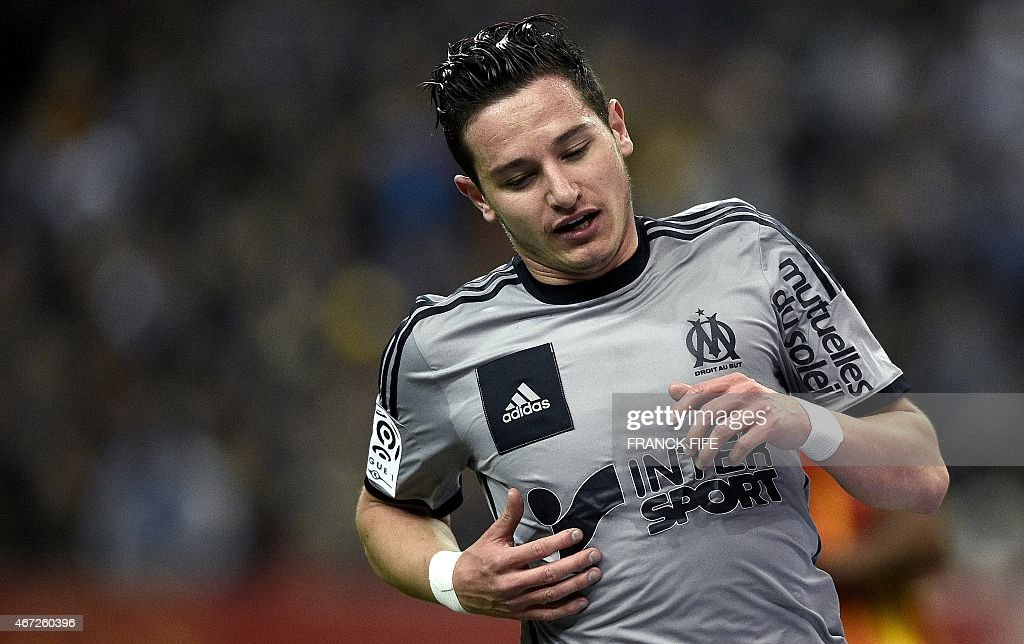 Marseille's French midfielder <a gi-track='captionPersonalityLinkClicked' href=/galleries/search?phrase=Florian+Thauvin&family=editorial&specificpeople=9157453 ng-click='$event.stopPropagation()'>Florian Thauvin</a> reacts during the French L1 football match between Lens and Marseille on March 22, 2014 at the Stade de France in Saint-Denis, north of Paris.
