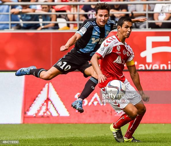 Marseille's French midfielder Florian Thauvin vies with Reims' Algerian defender Aissa Mandi during the French L1 football match Stade de Reims vs...