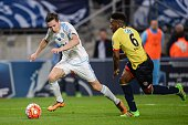 Marseille's French midfielder Florian Thauvin vies with Sochaux' French defender Jeando Fuchs during the French Cup semifinal football match between...